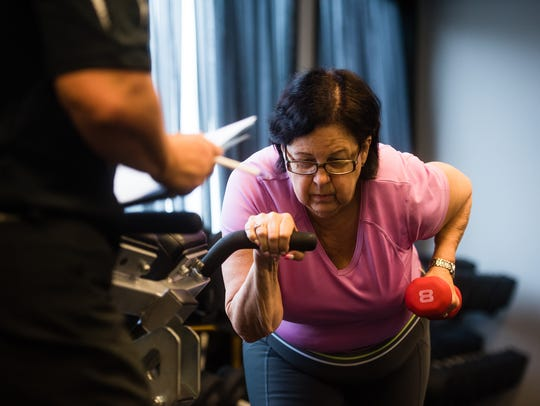 Jane Cooper, of Hanover, works on strength training