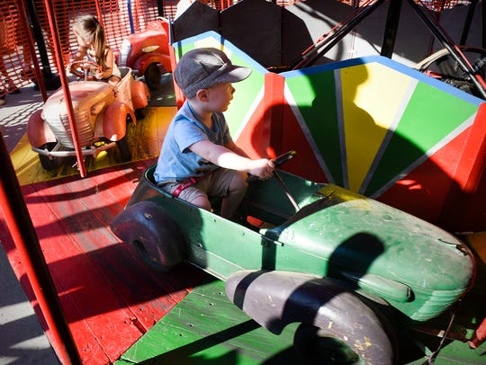 A carousel ride with vintage vehicles is a big hit