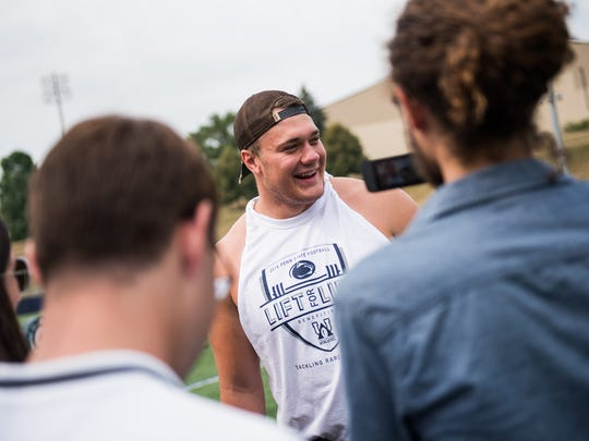 Penn State's Andrew Nelson talks to the media before the start of the 14th annual Lift for Life on Saturday July 16, 2016 at Penn State University.