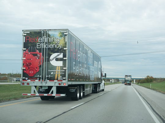 A Cummins Inc. semi-truck makes its way down the highway.