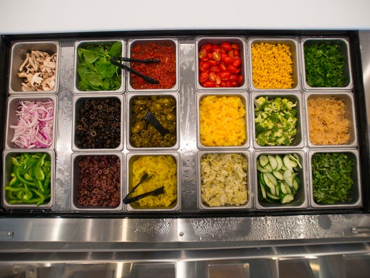 Different pizza and salad toppings at Pieology on Wednesday, Sept. 7, 2016, in Montgomery, Ala.
