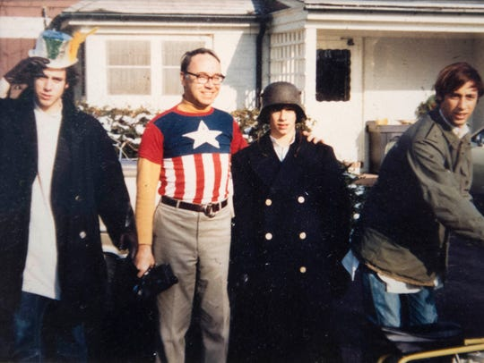 Tom Wolf, right, with brothers Andy, left, and Hank,