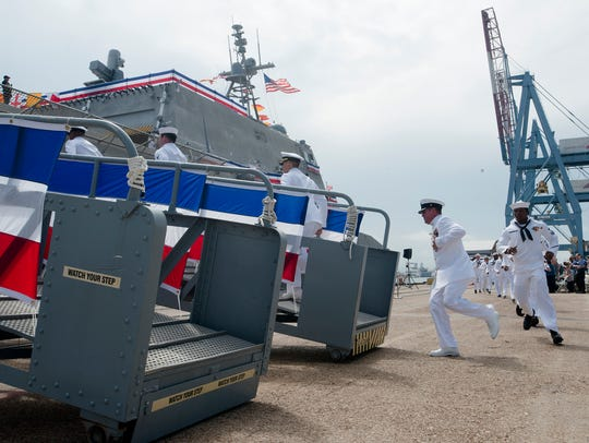 Shipman take their ship during the Commissioning of