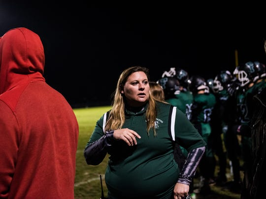 Fairfield athletic director Crystal Heller works on the sidelines Friday night Oct. 14, 2016 during Fairfield High School's Friday night football game against York County Tech.