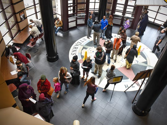 In this Nov. 7, 2016 file photo, a line of absentee voters extends into the rotunda of the Stearns County Administration Center in St. Cloud.