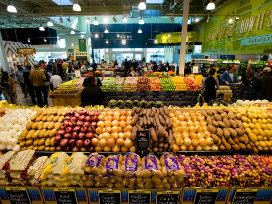 Shoppers walk the Montgomery Whole Foods store for