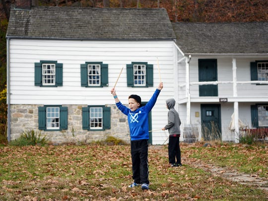 Colin Hill, 9, of Montvale, plays the 19th century
