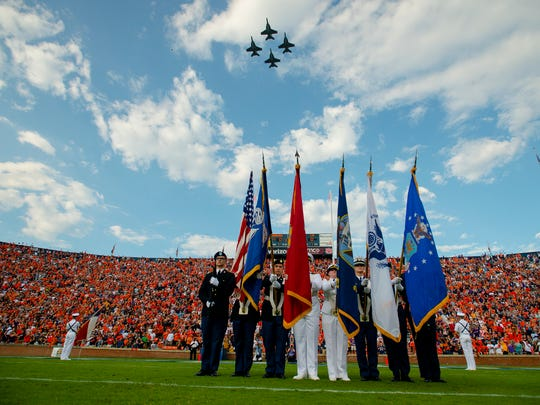 Members of the Auburn ROTC present the colors before