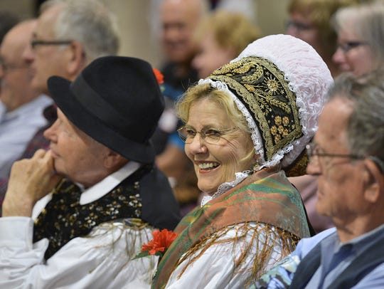 Dressed in traditional Slovenian costume, Albin, left,