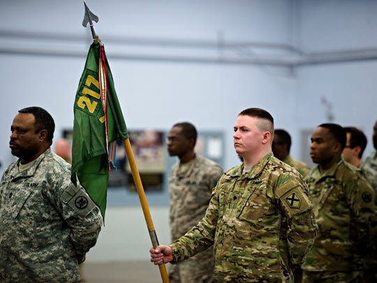 Members of the 217th Military Police Company stand