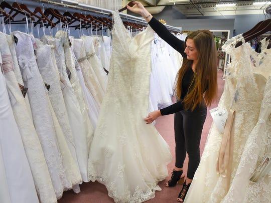 Lexi Johnson shows a wedding dress Wednesday, Jan. 4, at Carrie Johnson Bridal in Waite Park.