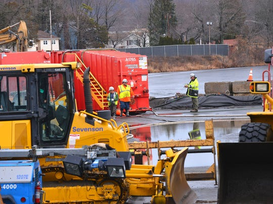 Soil dredged from Pompton Lake was brought to a concrete apron on the lakeside to be hauled away.