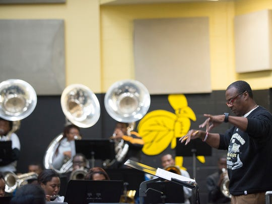 Director James Oliver works with some of the Alabama State Marching Band members during  practice on Wednesday, Jan. 11, 2017 at ASU in Montgomery, Ala.