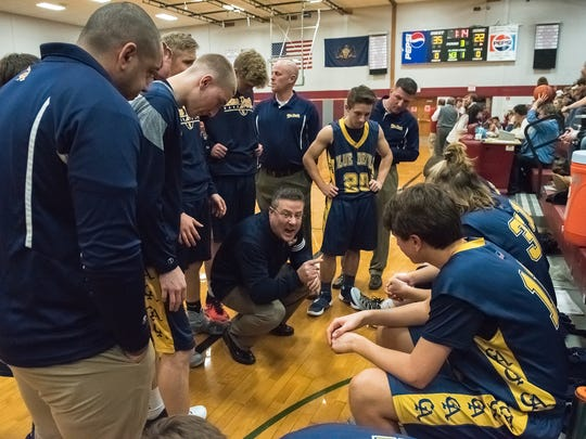 Greencastle's coach Rick Lewis talks to his team during a timeout at a boys basketball game earlier this season.