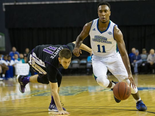 Texas A&M-Corpus Christi's Kareem South drives the ball up the court during the first half of their game against Stephen F. Austin at the American Bank Center on Thursday, Jan. 19, 2017.