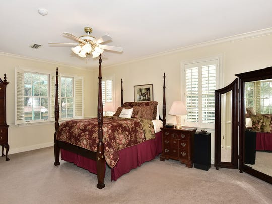 4450 Devereaux Drive, thr master bedroom with a view of the lush property.