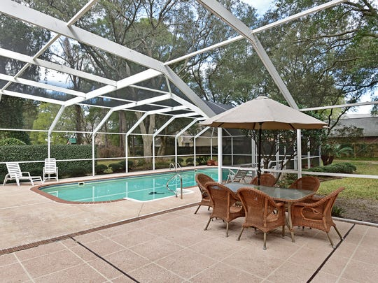 4450 Devereaux Drive, the screen enclosed pool with patio space.