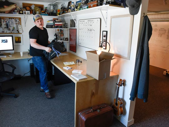 Guytano Magno, owner of Studio 203, works in his office