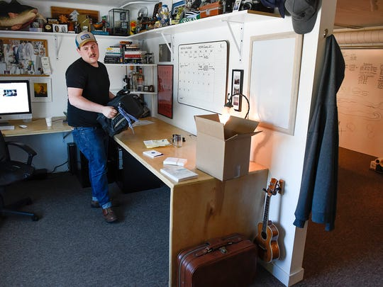 Guytano Magno, owner of Studio 203, works in his office Tuesday, March 7, in St. Cloud. Studio 203 has a large common space to work and socialize with others and individual offices.