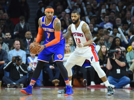 Knicks forward Carmelo Anthony controls the ball while Pistons forward Marcus Morris defends himself in 2017.