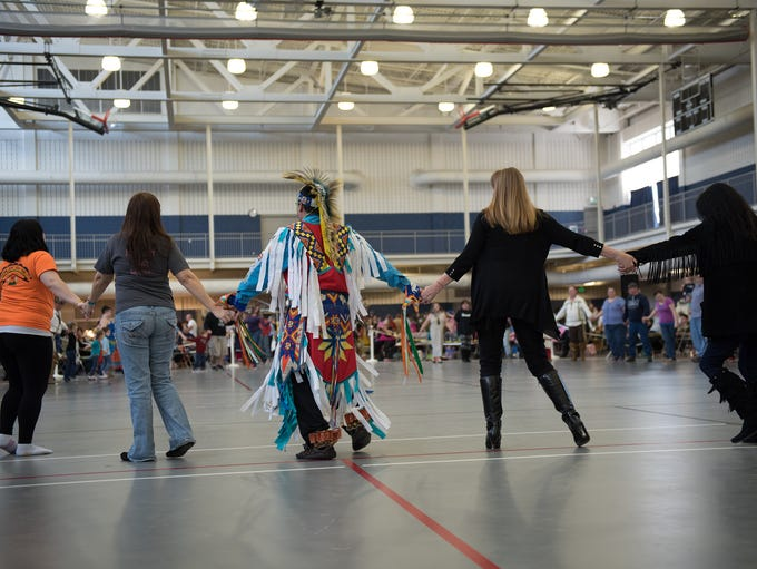 Attendees join in the pow-wow for the friendship dance