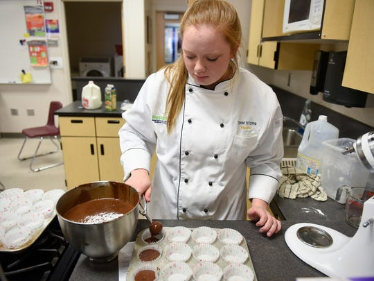 Culinary management team member Madelyn Adamski concentrates on her work Wednesday, March 15, at Sauk Rapids-Rice High School.