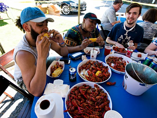 From left, Savon Gray and Connie Oatts eat corn during the 13th Annual Crawfish Boil on Saturday, April 1, 2017, in Montgomery, Ala. Last year the Crawfish Boil raised more than $30,000. All the proceeds of the boil are donated to Easter Seals of Central Alabama's Autism services. Two tons of crawfish were boiled and served.