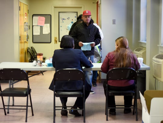 Housing officials accepting an application for federal
