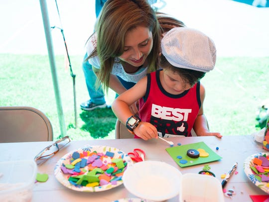 Maria Paz helps her son, Mateo Guerrero, 4, with a craft during the FLIMP Festival at Montgomery Museum of Fine Arts on Saturday, May 6, 2017, in Montgomery, Ala.