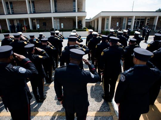 Montgomery Police Officers salute as the names of deceived Montgomery Police Officers are read off during a the Montgomery Police 2017 Memorial Day Service on Wednesday, May 17, in Montgomery, Ala., The service was held in memory of the 28 fallen officers who have died in service of Montgomery.
