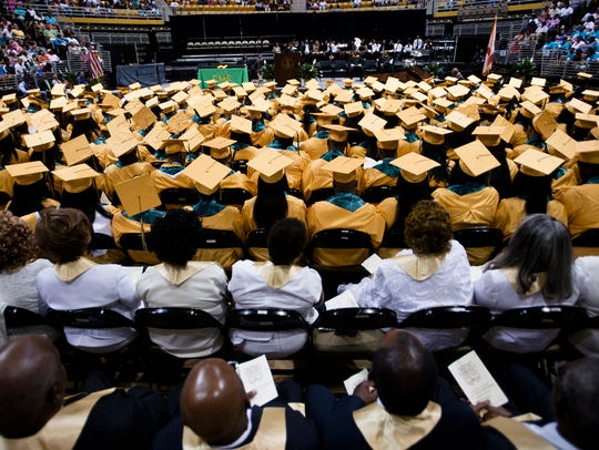 Carver graduates sit during Carver High School's Graduation