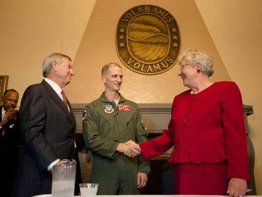 Gov. Kay Ivey shakes the hand of Col. Randy Efferson after signing military support bills on Tuesday, May 23, 2017, at Maxwell Air Force Base in Montgomery, Ala.