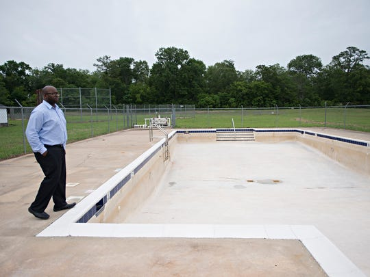 Aben Muhammad, Regency Park Community Center assistant director, looks at the pool while on a tour on Tuesday, May 30, 2017, at Regency Park Community Center in Montgomery, Ala.