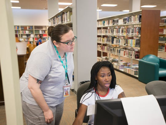Suzanne Horton, left, helps Ashley McWilliams print a document on Tuesday, June 6, 2017, at the Morgan Library in Montgomery, Ala.