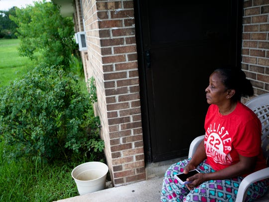 Nancy Pettaway sits on her front porch in Smiley Court