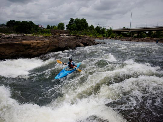 A Whitewater Express employee kayaks down the Chattahoochee