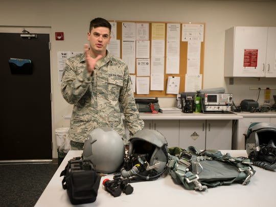 Staff Sgt. Justin Bruce talks about the F-16 pilots equipment at Dannelly Field in Montgomery, Ala., on Thursday, June 8, 2017.