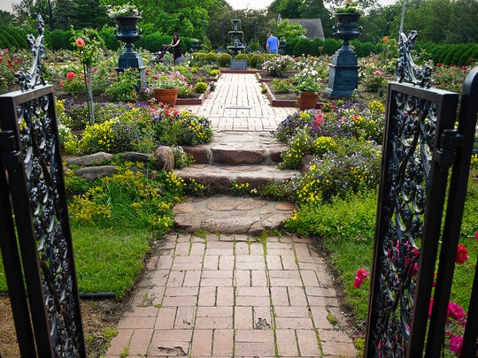 A wrought iron gate leads into one of the garden areas  June 20, 2019 in Clemens Gardens.