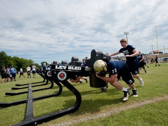 Catholic linebackers push a sled during the Alabama Christian Academy 7 on 7 tournament on Tuesday, June 27, 2017 in Montgomery, Ala.