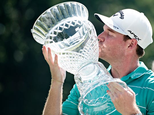 Grayson Murray kisses the PGA Barbasol Championship trophy after winning on Sunday, July 23, 2017, in Opelika, Ala.