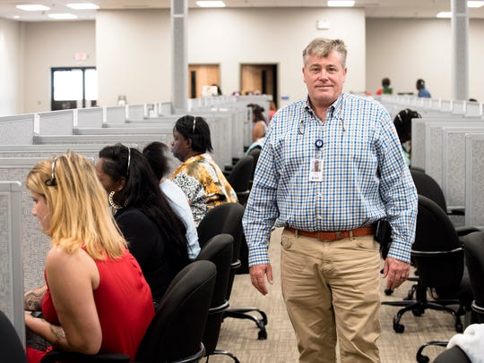 Rick Burley, ASK owner, stands inside the new ASK facility