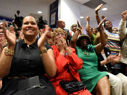 The crowd cheers as Democratic gubernatorial nominee Phil Murphy formally announces Sheila Oliver as his running mate during a press conference in Newark on Wednesday.