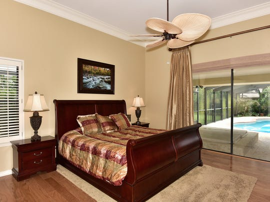 315 Plantation Hill Road, the master bedroom with hot tub and pool access.