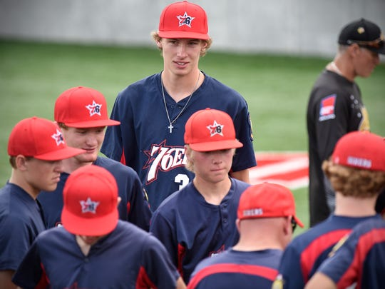 Trevor Koenig meets with fellow 76er teammates during a game earlier this season in Collegeville.
