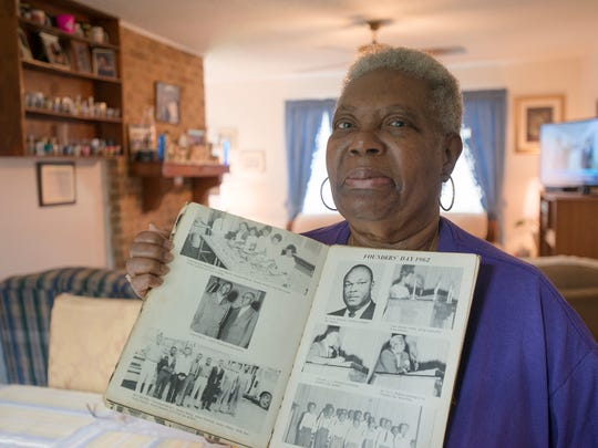 Alma Watson Clark holds her high school yearbook from