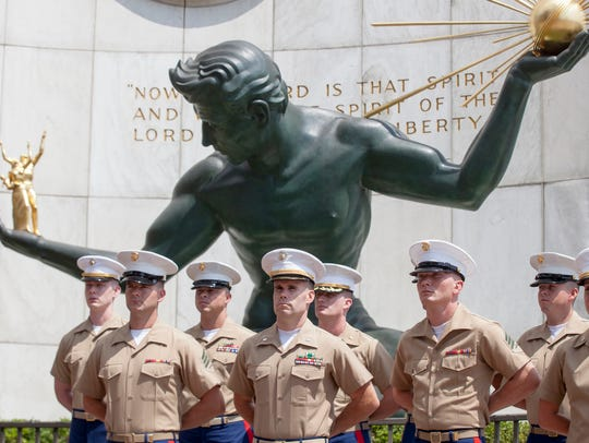 Members of the United States Marine Corps wait for