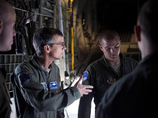 Airmen from the 908th Airlift Wing discuss the mission of providing a jump platform for the soldiers of the 1st Battalion, 507th Parachute Infantry Regiment, onto Maxwell Air Force Base on July 6. The 908th and the Fort Benning-based Army unit have a longstanding partnership.