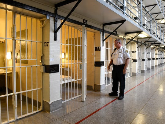 In this August 2017 file photo, Security Captain Dean Weis stands near some cells during a tour of the Minnesota Correctional Facility- St. Cloud.