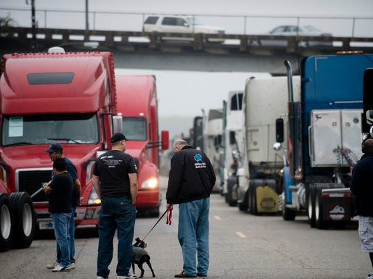 Truck drivers line up their trucks outside Maxwell