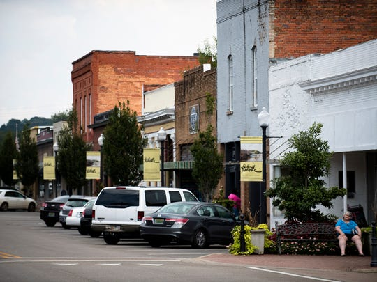 A pedestrian sits in downtown Prattville, Ala., on